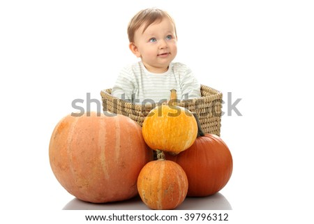 Young baby girl with pumpkins, isolated