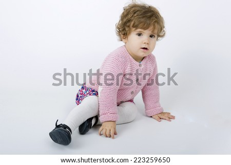 young baby portrait on a grey background