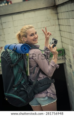 Young backpacker taking photos - stock photo