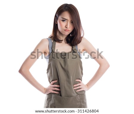 Young bad gesturing emotion asian housewife wearing  kitchen apron posing on white background - stock photo