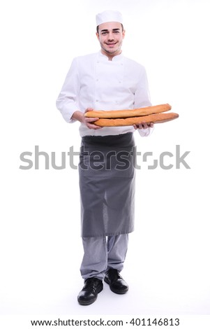 young baker isolated on white studio background holding a traditional bread french baguettes