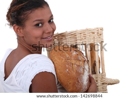 Young baker with a loaf of bread - stock photo