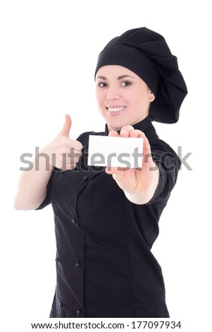 young baker woman in black uniform showing visiting card isolated on white background - stock photo