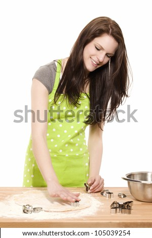 young baking woman using christmas molds on dough with white background - stock photo