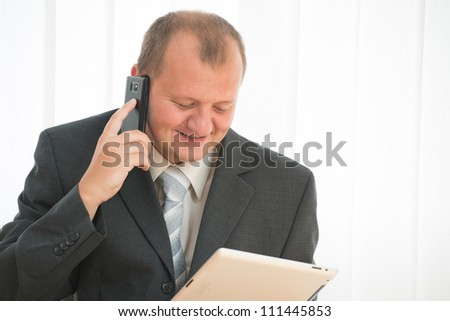 young bald man  works with tablet pc and smart phone