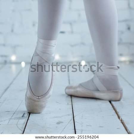Young ballerina dancer in tutu showing her techniques, selective focus - stock photo
