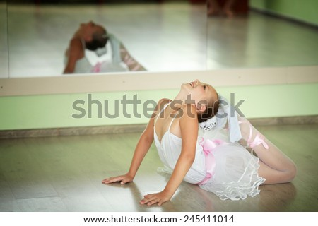 Young ballerina in tutu showing her techniques - stock photo