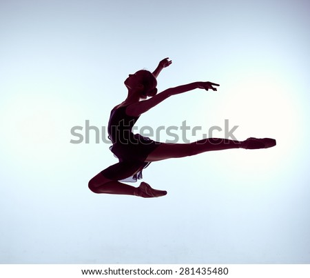 young ballet dancer jumping on a grey background. Ballerina is wearing in blue dress and pointe shoes. The outline shooting - silhouette of girl - stock photo