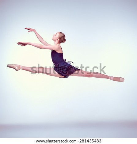 https://thumb1.shutterstock.com/display_pic_with_logo/2639893/281435483/stock-photo-young-ballet-dancer-jumping-on-a-grey-background-ballerina-is-wearing-in-blue-dress-and-pointe-281435483.jpg