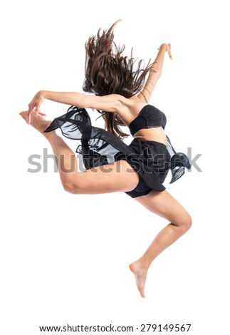 Young ballet dancer jumping over white background