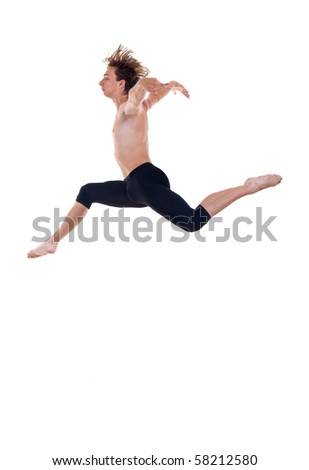 young ballet dancer practicing high jumps over white