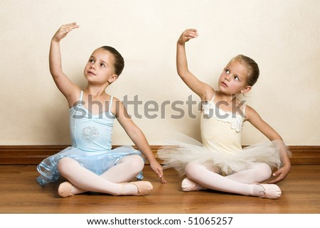 Young ballet dancers in a studio with wooden floors - stock photo