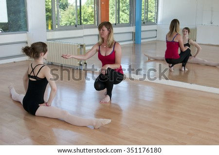 Young ballet student in class with her tutor - stock photo