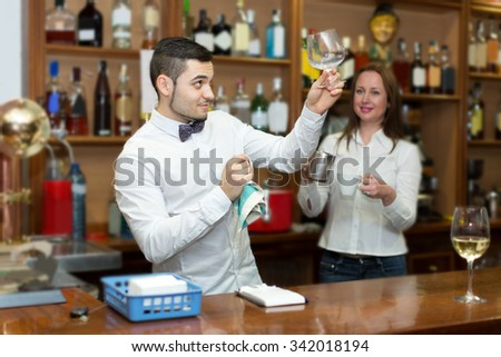 young bar staff working at the customer service counter - stock photo