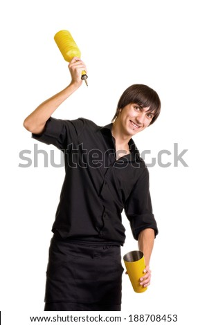 Young bartender does a trick with a shaker and bottle on white background