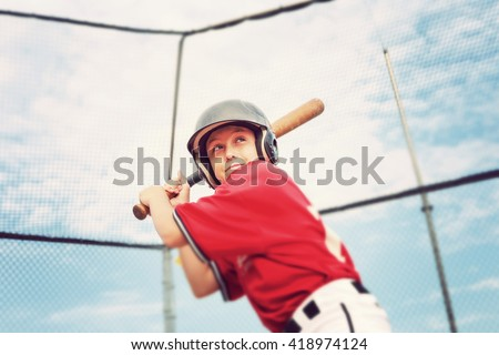 Young baseball player batting - stock photo