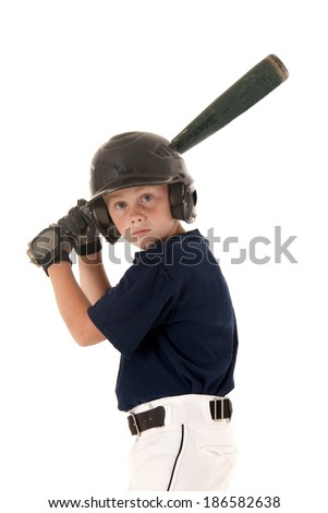 Young baseball player focused ready to bat - stock photo