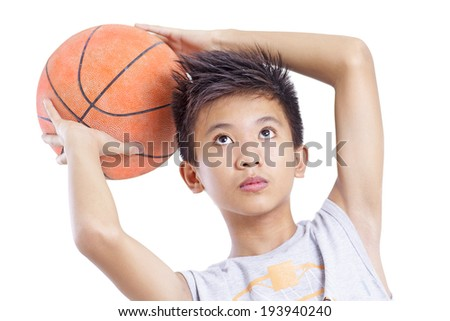 Young basketball player concentrating in shooting the ball. Isolated in white background. - stock photo