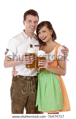 Young Bavarian couple in love with Oktoberfest stein beer.Isolated on white background. - stock photo