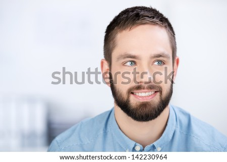 Young beard businessman is smiling in office