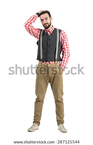 Young bearded hipster with hand through hair. Full body length portrait isolated over white studio background.  - stock photo