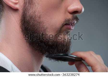 Young bearded man is preparing his image