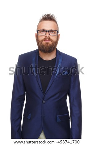 Young bearded man isolated at white background. Portrait of a confident stylish guy in eyeglasses looking at camera. Boy style, trendy hipster with cool hairstyle in blue suit. - stock photo