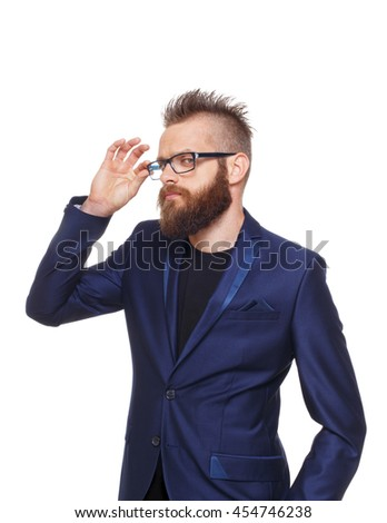 Young bearded man wearing glasses isolated at white background. Portrait of a confident guy in stylish eyeglasses. Boy style, trendy hipster with cool hairstyle in blue suit. - stock photo