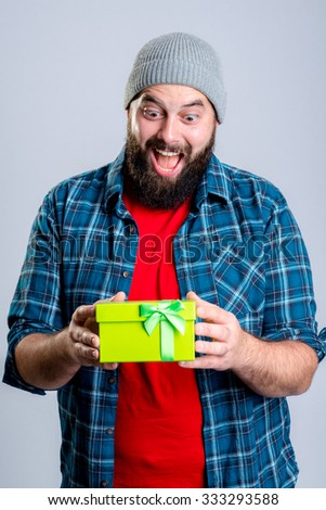 young bearded man with green gift box - stock photo