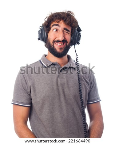 young bearded man with headphones - stock photo