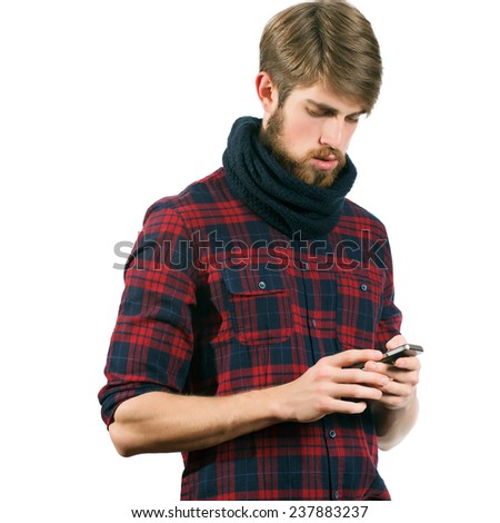 Young bearded man with mobile phone isolated on white background