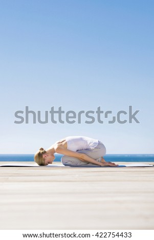 Young beatiful woman maditating and practicing yoga