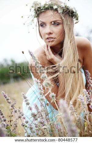 Young beautfiul woman walking outdoors at summer - stock photo
