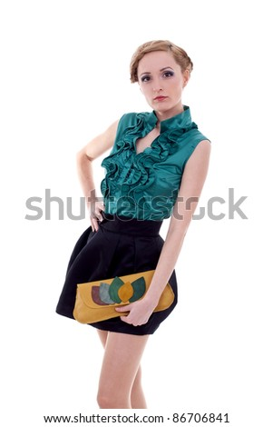young beautiful adult girl wearing elegant dress and purse on white - stock photo
