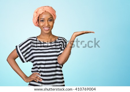 Young beautiful african american woman showing copy space - stock photo