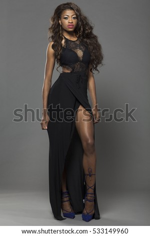 Young beautiful African girl posing in studio.
