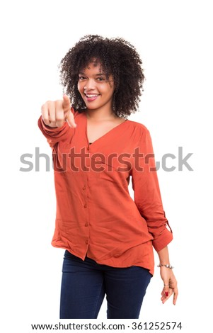 Young beautiful african woman pointing at you, isolated over white