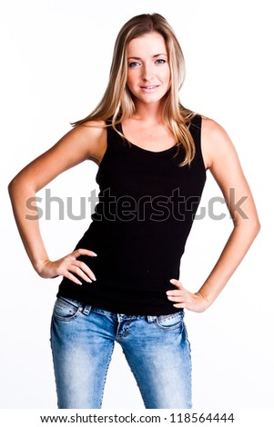 Young, beautiful and happy woman in a black shirt and blue jeans - stock photo