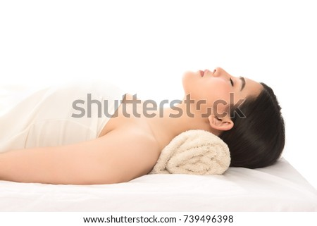 Young  beautiful and healthy asian woman in spa salon. Traditional oriental aroma therapy and beauty treatments. Beautiful spa woman lying on the couch.
