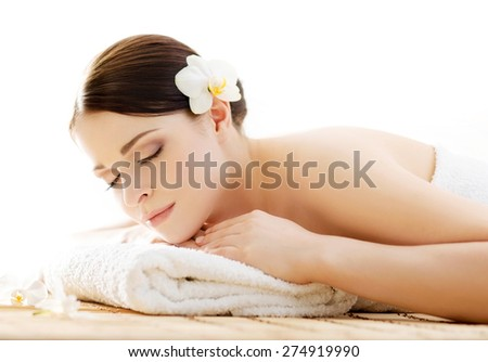 Young, beautiful and healthy woman in spa salon. Traditional oriental aroma therapy and beauty treatments.  - stock photo