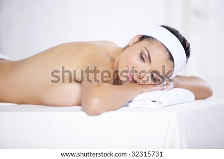 Young beautiful and relaxed taking spa treatment