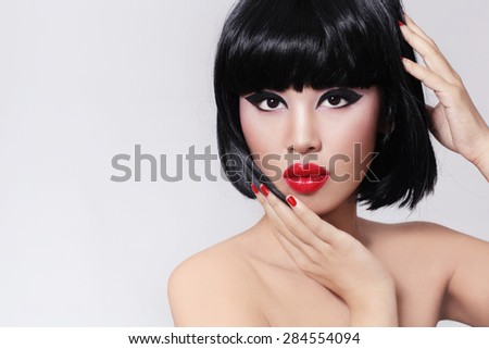 Young beautiful asian girl with stylish bob haircut and red lipstick - stock photo