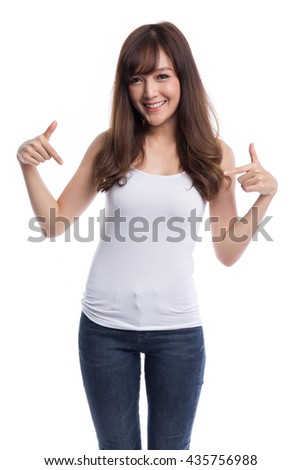Young beautiful asian woman pointing at her white t-shirt, design concept, blank white t-shirt concepts, isolated on white background