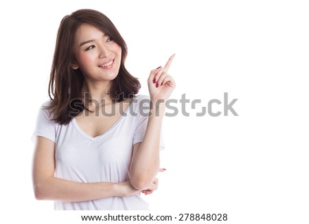 Young beautiful asian woman pointing to copy space, isolated on white background