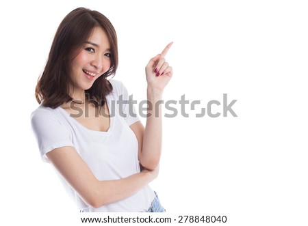 Young beautiful asian woman pointing to copy space, isolated on white background - stock photo