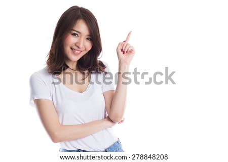 Young beautiful asian woman pointing to copyspace, isolated on white background - stock photo