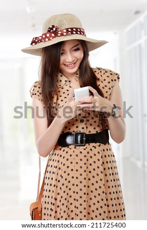 young beautiful asian woman using cell phone - stock photo