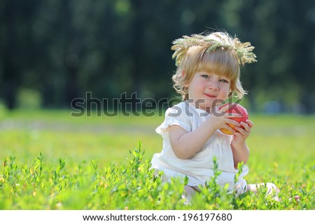 young beautiful baby girl eat apple - stock photo