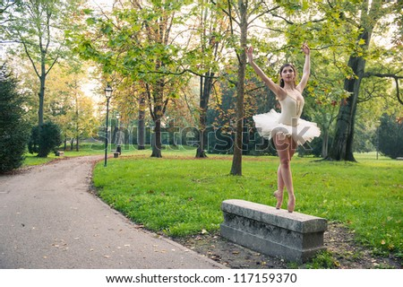 Young beautiful ballerina dancing outdoors in a park. Ballerina Project.