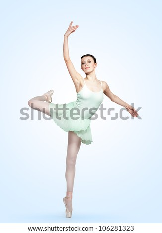 young beautiful ballerina on a gray background